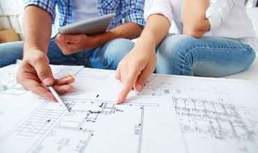 Looking at schematic drawings for construction