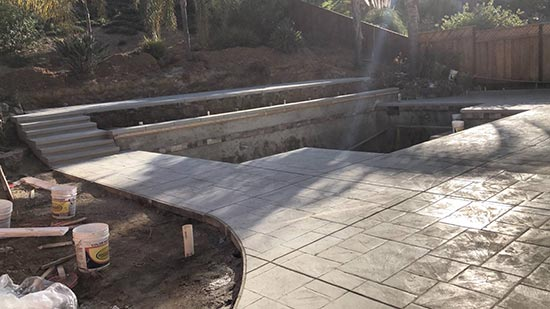 Concrete pool deck with stamped concrete in Hayward California