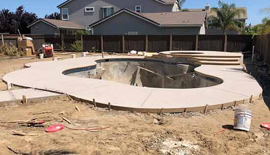 Brand new concrete pool deck in Fremont California