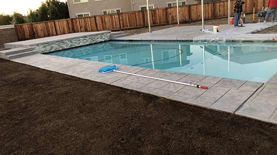 Brand new concrete pool deck in Hayward California
