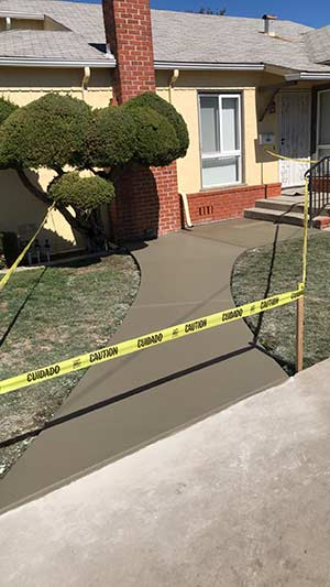 concrete walkway to front door in Hayward California